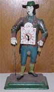 Tin Man Clock Peddler - Circa 1960